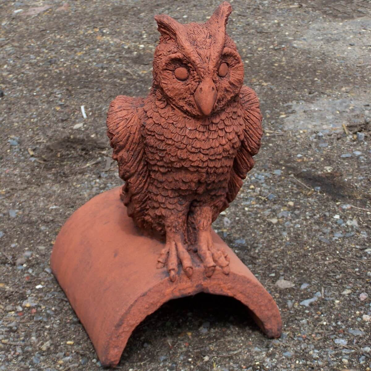 owl roof finial with aged terracotta appearance