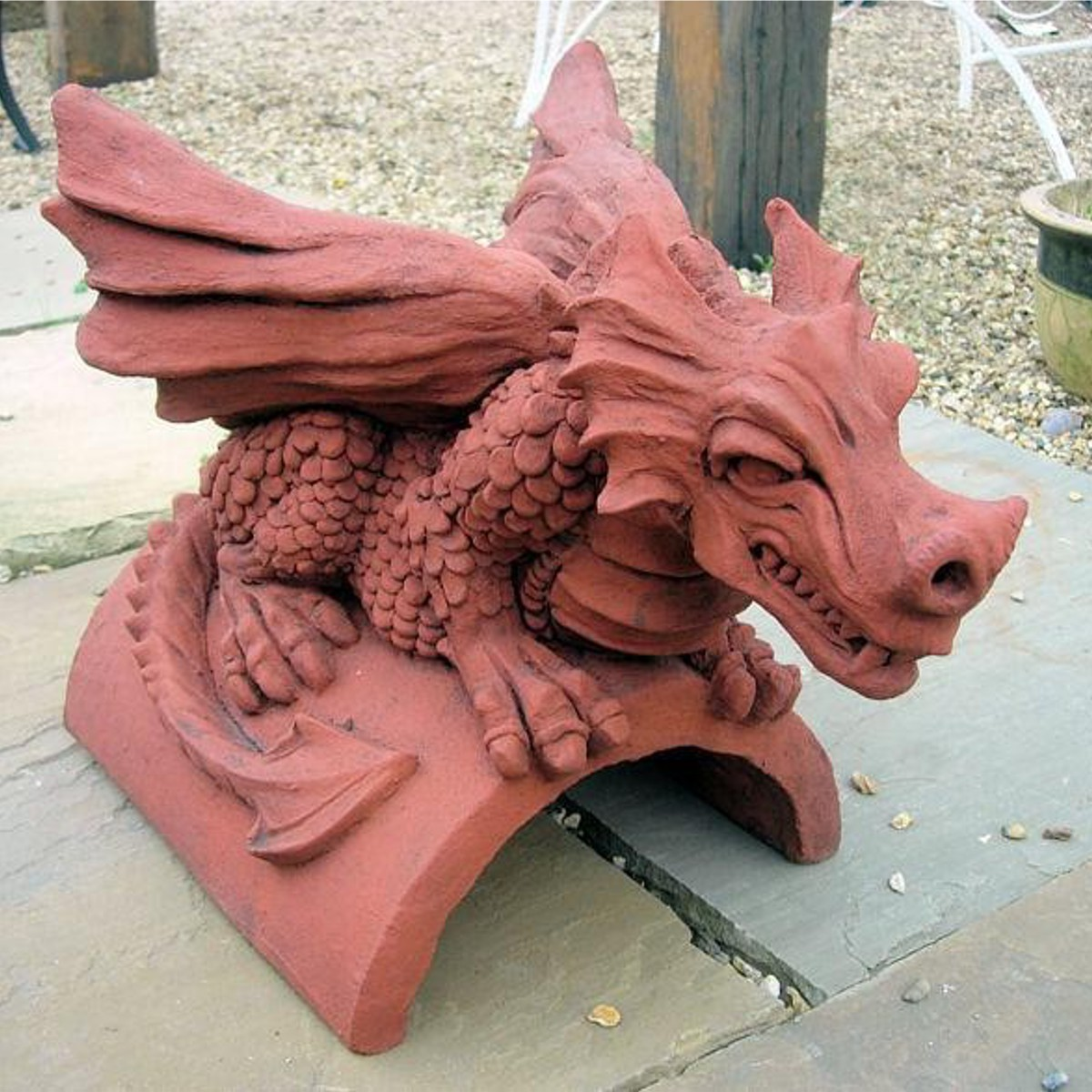 dragon finial sitting on indian stone