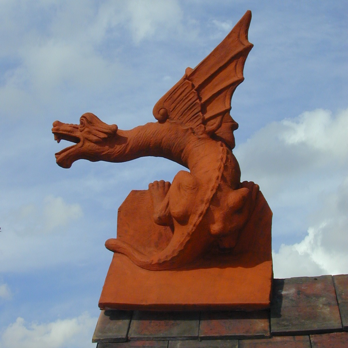 large terracotta wyvern installed on the roof